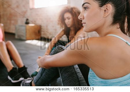 Young Woman Sitting With Friends In Gym