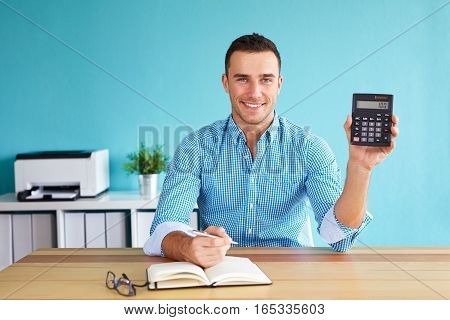 Smiling Man Showing A Calculator