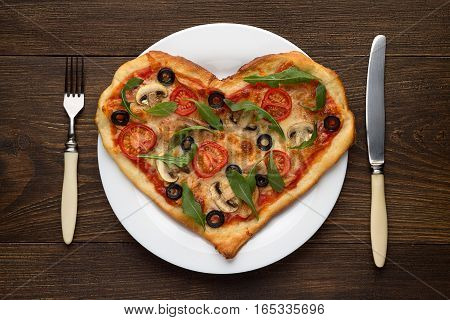 Heart Shaped Pizza On White Plate With Fork And Knife Ready To Eat. Italian Dish For Valentines Day