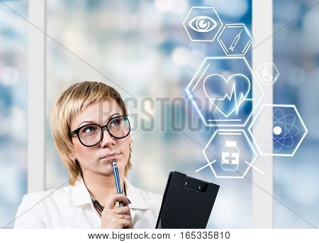 Female doctor working with healthcare icons. Modern medical technologies concept