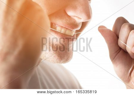 Smiling man,guy hipster, use dental floss, brushing teeth, Dental hygiene and care