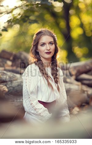 Beautiful Woman In Traditional Romanian Costume In Park