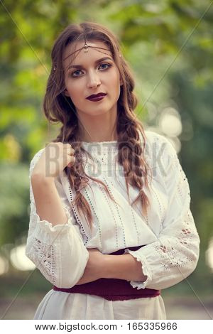 Portrait Of Beautiful Woman In Traditional Romanian Costume