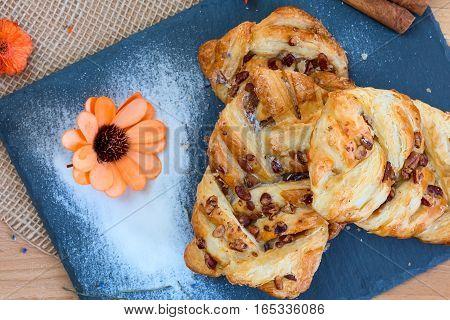 marple and pecan plait pastry sweet food breakfast with orange flower