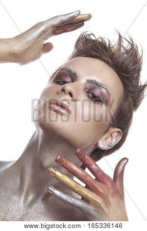 Man Wearing A Conceptual Make Up With Giltter