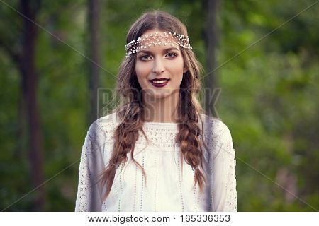 Portrait Of Smiling Woman In Park
