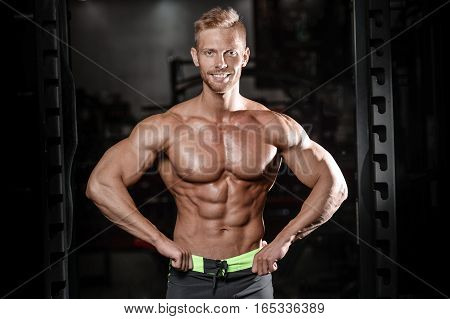 Strong And Handsome Athletic Young Man Muscles Abs And Biceps.