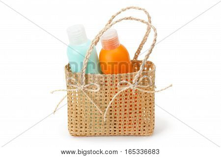 shampoo and conditioner in the basket isolated on white background
