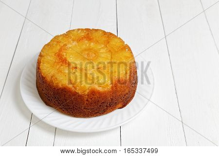 Pineapple Upside Down Cake On White Wooden Table