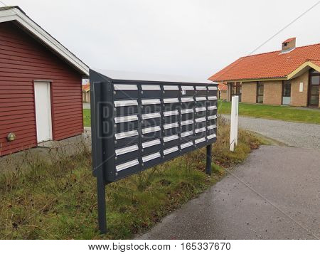 Communal letterbox collection at Holiday Cottages on Flensburg Fjord on cold winters day