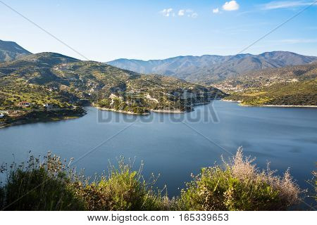 Cyprus landscape with mountains lake and village.