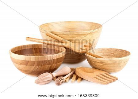 Empty bamboo bowls and wooden items isolated on white background.