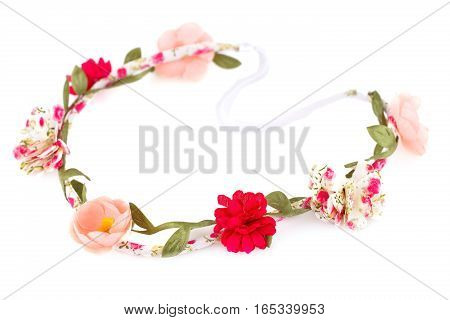 Hair rim with flowers isolated on white background.