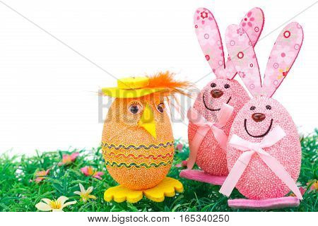Easter egg and bunnies decoration on artificial grass.