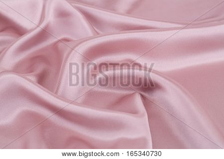 Pink silk fabric texture as a background.