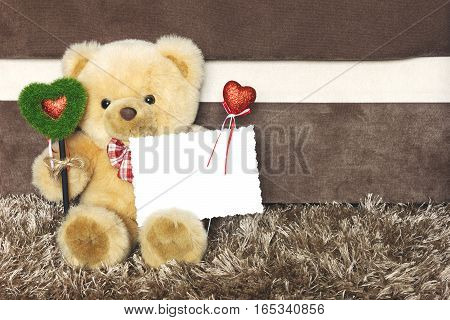 Teddy bear with red hearts wishes you a happy Valentines day. Vintage toning