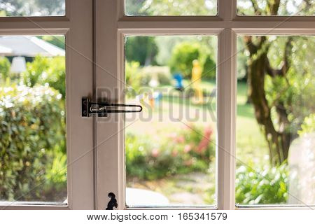 Nature in the window. Frames with glass panels. House in the countryside.