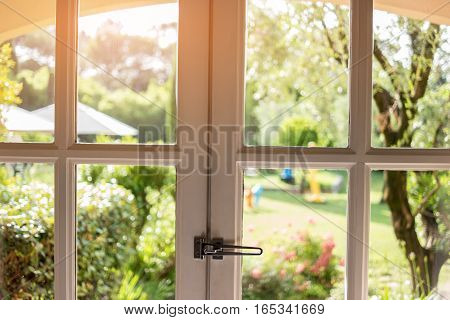 Nature in window. Frames and glass panels. Spend summer in countryside house.