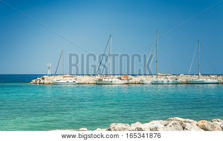 Yachts at the pier on a sunny day, Greece