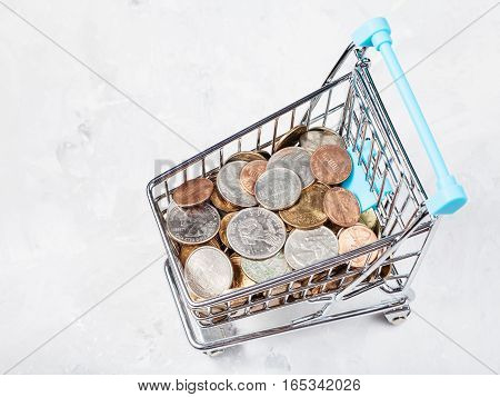 Cart With Us Coins On Concrete Plate