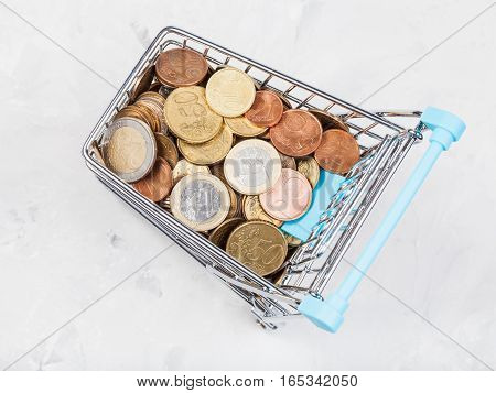Cart With Euro Coins On Concrete Board