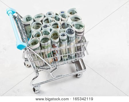 Trolley With Dollar Banknotes On Concrete Plate