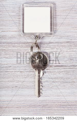 Key With White Blank Keychain On Wood Table