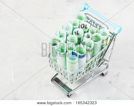 Trolley With Euro Banknotes On Concrete Board