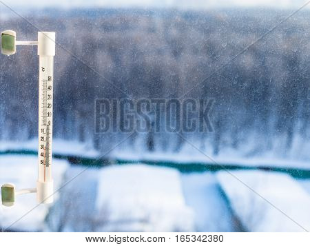 Thermometer On Home Window In Cold Winter Day