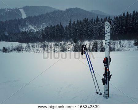 Winter mountains and ski equipment in the snow. Skiing resort winter holidays in Carpathians Bukovel Ukraine.