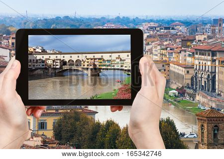 Tourist Photographs Ponte Vecchio In Florence