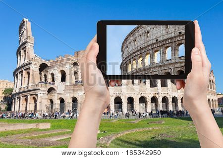 Tourist Photographs Colosseum In Rome City