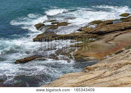 Water dripping between rocks in Arpoador Stone Ipanema Rio de Janeiro