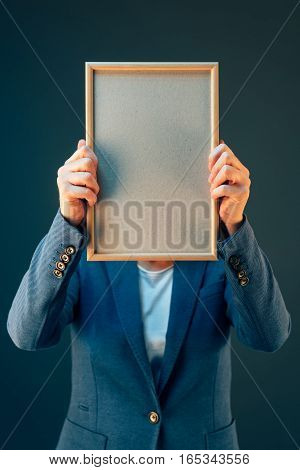 Business woman holding blank diploma certificate as copy space mock up
