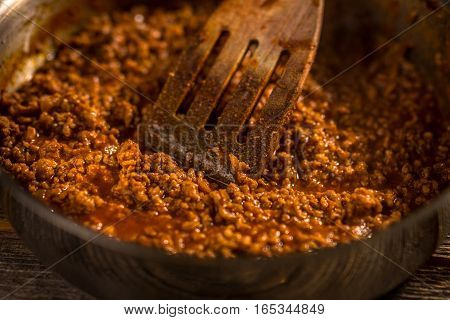 Homemade tasty bolognese sauce in a pan