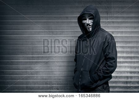 Anonymous Man On Grey Shutter Door