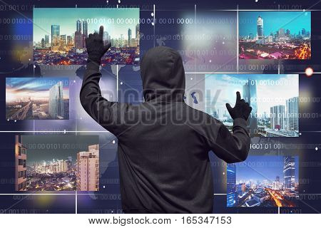 Back View Of A Hacker Man Touching Virtual Monitor