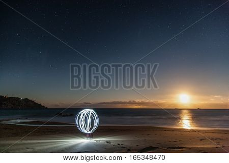 Light orb on the beach in the moonlight