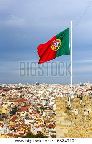 Waving portuguese flag on top of Saint Jorge Castle in Lisbon, Portugal