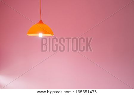 modern ceiling lights with pink cement wall background.