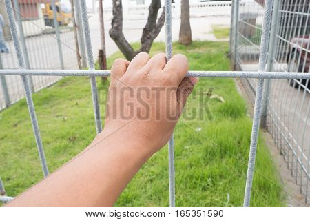 human's hand catching grille at restricted area concept of prevention on private zone.