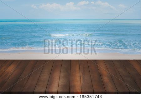 montage of old wood shelf on blurry blue sea background concept of product shelf on natural landscape.