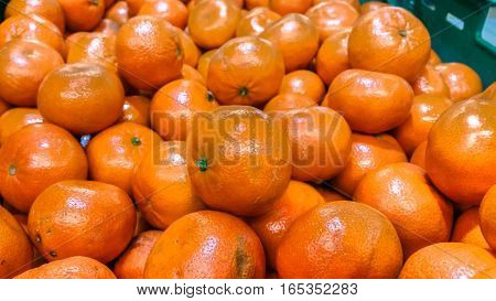 Group Of Fresh Organic Mandarins In A Marketplace