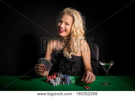 Flirty woman playing poker at the casino
