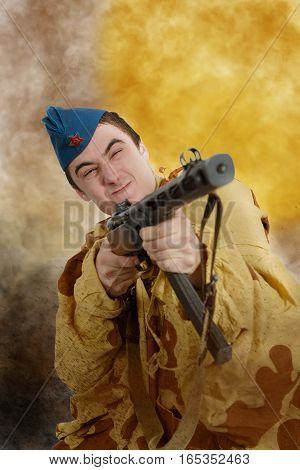 young Soviet soldier ww2 with machine gun attack