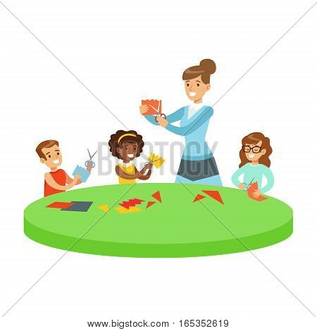 Three Children In Art Class Crafting Applique Cartoon Illustration With Elementary School Kids And Their Teacher In Creativity Lesson. Happy Schoolkids Doing Paper Craft With Demonstration From Adult Woman.