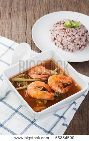 kitchen table with fish and vegetable ragout sour soup with shrimp and water hot Sour curry thai local cuisine food. selective focus on top view.