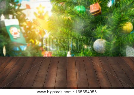 montage of wood shelf for advertisement on blurry Christmas tree background concept of shelf for showing products on blurry pine tree decoration for Christmas day.