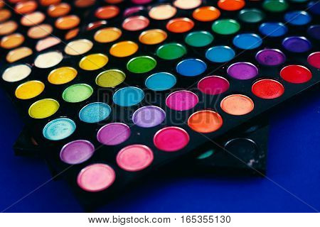 professional colorful eyeshadow palette in blue background