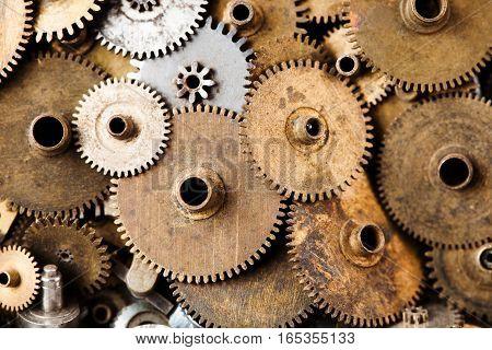 Steampunk gears background. Aged mechanical clock wheels close-up. Shallow depth field, soft focus.